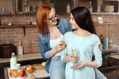 Happy young women holding bocals with champagne Stock Image