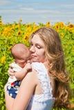 Happy mother and newborn child Stock Photo
