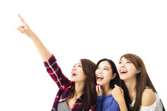 Happy young  women looking and pointing something Royalty Free Stock Photo