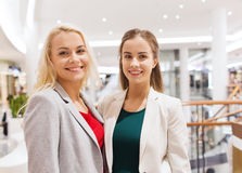 Happy young women in mall or business center Royalty Free Stock Photography