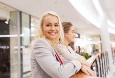 Happy young women in mall or business center Royalty Free Stock Images
