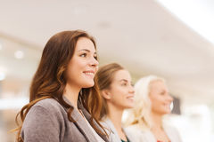 Happy young women in mall or business center stock image