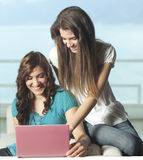 Happy young women with netbook Stock Photo