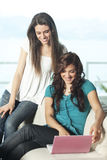 Happy young women with netbook Royalty Free Stock Photo