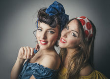 Happy young women in retro style clothing Stock Photo