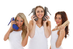Happy young women with shoes. Stock Photo
