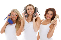 Happy young women with shoes. Stock Photography