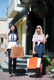 Happy young women shopping Royalty Free Stock Photography