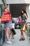 Happy young women shopping Royalty Free Stock Photos