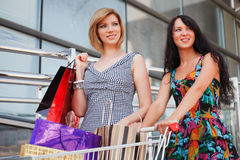 Happy young women shopping Royalty Free Stock Images