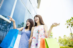 Happy Young Women with Shopping Bags Royalty Free Stock Photos