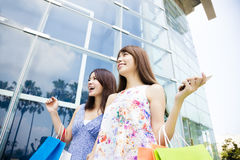 Happy Young Women with Shopping Bags Stock Image