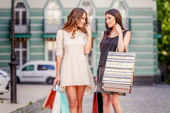 Happy young women with shopping bags. Happy young caucasian women with shopping bags outdoor Stock Photos