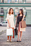 Happy young women with shopping bags. Happy young caucasian women with shopping bags outdoor Stock Image
