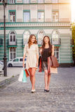 Happy young women with shopping bags. Happy young caucasian women with shopping bags outdoor Royalty Free Stock Photography
