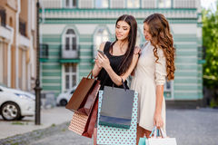 Happy young women with shopping bags. Happy young caucasian women with shopping bags outdoor Royalty Free Stock Photo