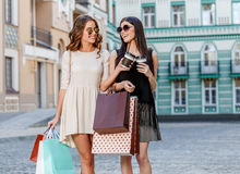 Happy young women with shopping bags. Happy young caucasian women with shopping bags outdoor Stock Photo