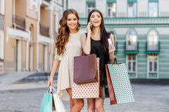Happy young women with shopping bags Royalty Free Stock Photo