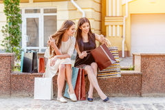 Happy young women with shopping bags. Happy young caucasian women with shopping bags outdoor Stock Photography