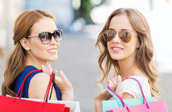 Happy young women with shopping bags in city Stock Photography