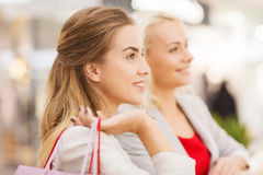 Happy young women with shopping bags in mall Stock Photography