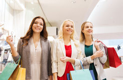 Happy young women with shopping bags in mall Stock Image