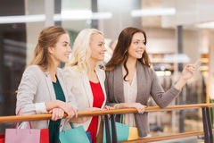 Happy young women with shopping bags in mall Stock Images
