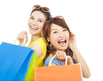 Happy young women with shopping bags Royalty Free Stock Photography