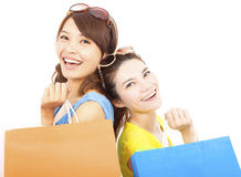 Happy young women with shopping bags Stock Photography