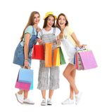 Happy young women with shopping bags. On white background Stock Photography