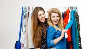 Happy women clothes shopping Stock Photo