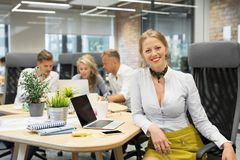 Happy woman sitting with co -workers. Happy young women sitting with co -workers in the meeting stock photo