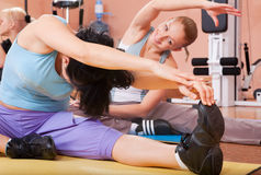 Happy young women stretching Stock Photography