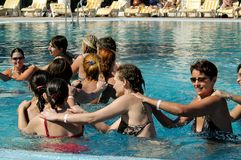Happy young women in the swimming pool. Hurghada, Egypt - November 9, 2006: Sun Rise Hotel. Happy young women in the swimming pool, hotel view, summer vacation Royalty Free Stock Images