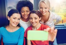 Happy young women taking selfie with smartphone Stock Photography