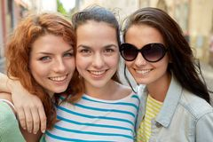 Happy young women or teenage girls on city street Royalty Free Stock Photos