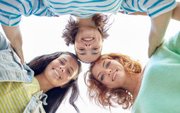 Happy young women or teenage girls on city street Royalty Free Stock Images