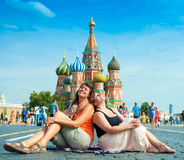 Happy young women visit Red Square Royalty Free Stock Photo