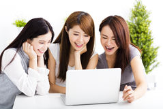 happy young women watching laptop  in living room Royalty Free Stock Photo