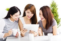 Happy young women watching tablet  in living room Royalty Free Stock Image