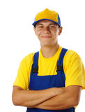 Happy young worker fold his arms and smile Royalty Free Stock Photography