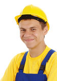 Happy young worker wearing hard hat Stock Image