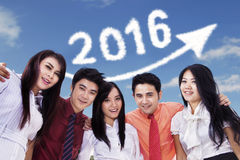 Happy young workers under number 2016 Royalty Free Stock Photography