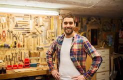 Happy young workman in checkered shirt at workshop Stock Photos