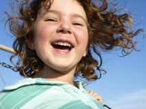 Happy youth. This young girls joy is expressed very clearly in her face. soft focus Stock Image