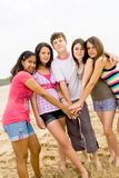 Happy youth. Group of happy youth playing on beach Royalty Free Stock Photography