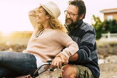 Free Happy Youthful Couple Enjoy The Bike Ride Together Man Carrying Woman And Both Laughing And Have Fun - Active And Cheerful People Royalty Free Stock Image - 194059236