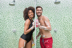 Happy youthful couple in love flirting while taking douche stock images