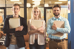 Happy youthful guys and lady getting ready for job interview stock images