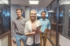 Happy youthful guys and lady successfully passing job interview royalty free stock photography